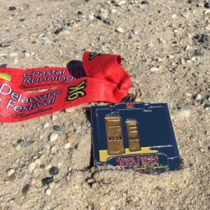 Medal and beach, all you need post race